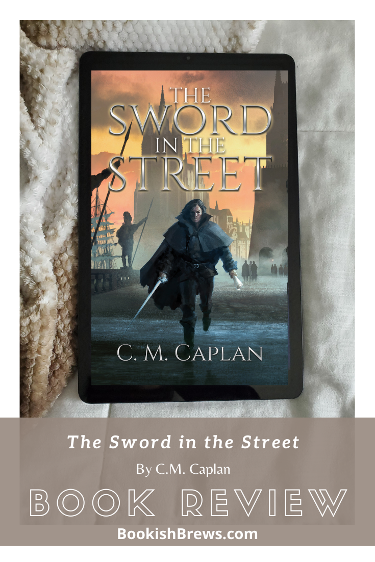 tablet sitting on blanket, and on the tablet screen is displayed the cover of the Sword in the Street. Banner in front of image saying Book Review